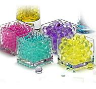 abordables -Hydrogel en forme de perle de cristal vert perles d'eau du sol de la boue poussent des bulbes de croissance de mariage de boule