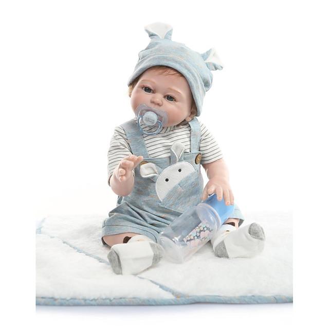 NPKCOLLECTION 22 pouce Poupées Reborn Bébé Mignon Implantation artificielle Yeux bleus Silicone complet cadeaux noël enfant avec vêtements et accessoires pour les cadeaux d'anniversaire et de